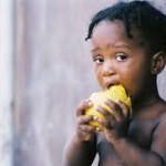 child eating mango